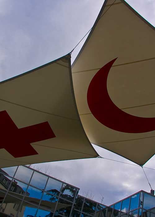 The Red Cross and Red Crescent symbols on two canvases at the ICRC headquarters in Geneva