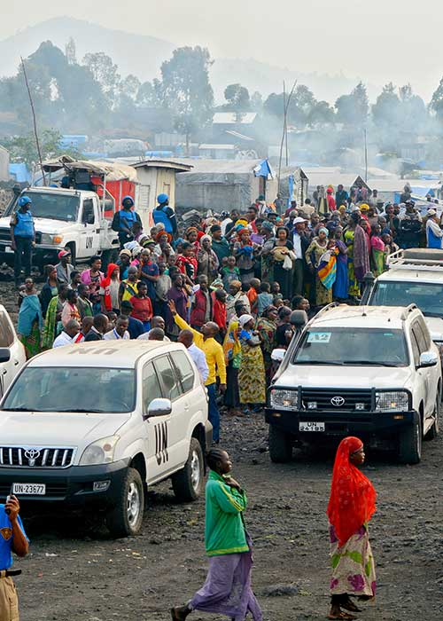 Several UN cars on a crowded street in North Kivu province, Democratic Republic of the Congo