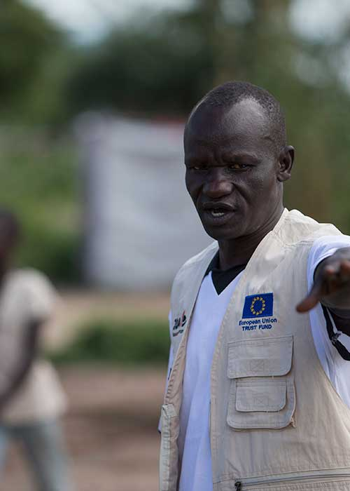 Humanitarian worker in Uganda giving directions