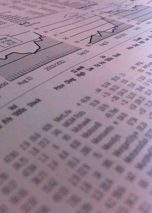 Financial newspaper with charts and figures