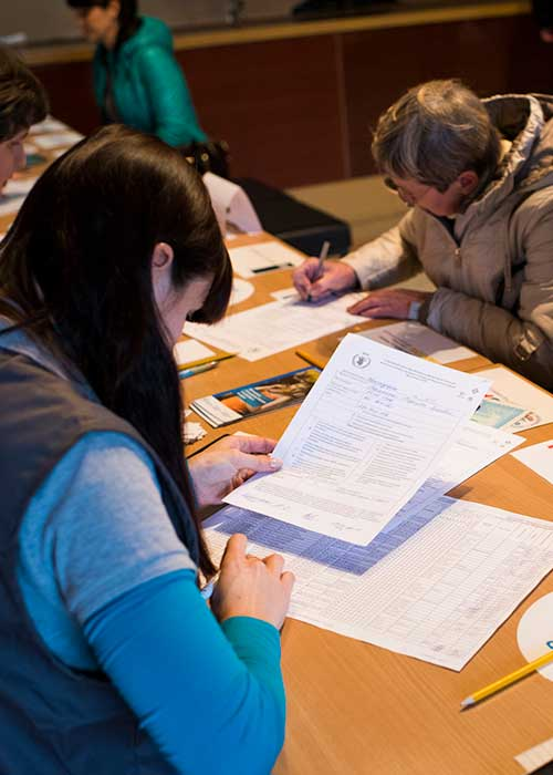 Humanitarian workers registering program participants