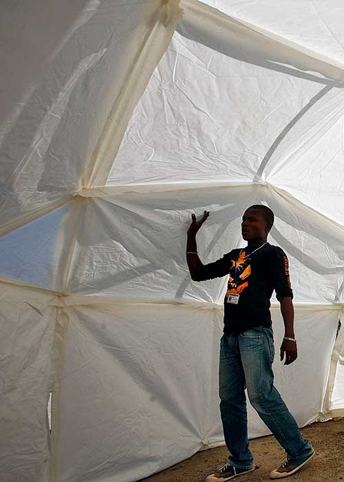 Staff member walking in newly erected tent