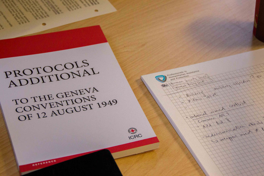 Geneva Conventions and a PHAP notebook during one of PHAP's courses in Geneva, Switzerland