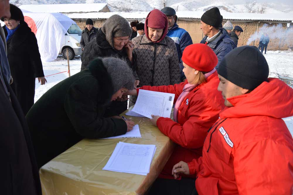 Women registering during natural disaster simulation in Kyrgyzstan